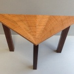 Triangular side table in ripple plane and black walnut